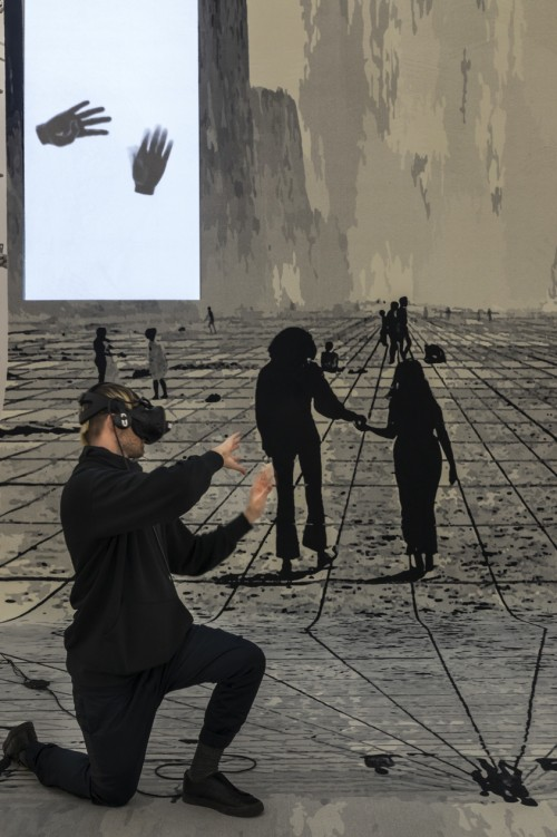 »Pre-Alpha Courtyard Games (raindrops on my cheek)«, 2017<br />VR-Installation, custom made VR Software build with Unity, VIVE VR Station, Leap Monitor Controller, custom made carpet, scaffold, plexiglass, projectors, clay<br />Installation view, Zeppelin Museum, Friedrichshafen, Germany, 2017