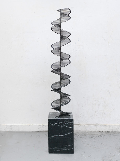 <i>Die Doppeltreppe</i>,       2017<br />      cut records, fabric, metal, marble plinth,        192 x 31 x 31 cm<br />
