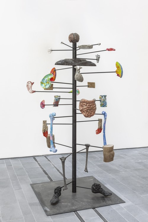 <i>Dig of No Body (Organ*isation)</i>,       2019<br />      aluminium, crystal, cement, copper, coal, grass seeds, horn, iron, resin, pigment, plastic trash, sand, soil, steel,        185 x 60 x 50 cm<br />      Installation view 16th Istanbul Biennial, Turkey, 2019