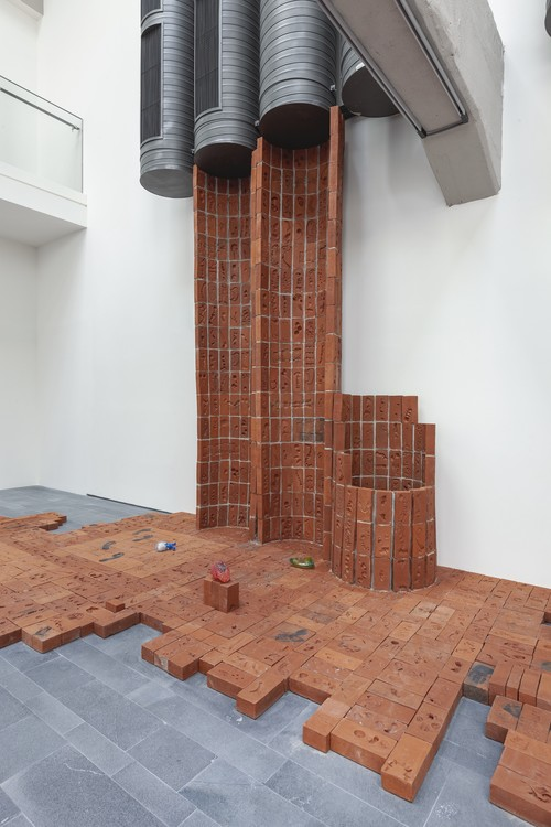 <i>Body Bricks</i>,       2019<br />      2455 individually imprinted clay bricks (replica of original brick from the historical shipyards, Golden Horn), in cooperation with Işıklar Tuğla, Bartın,       <br />      Installation view 16th Istanbul Biennial, Turkey, 2019
