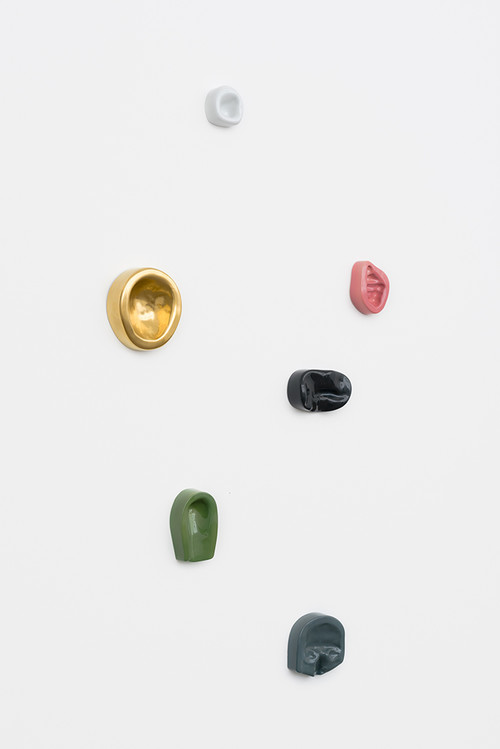 <i>Leaning Wall (6)</i>,       2013/2014<br />      Imprints of female and male body parts cast in colour-glazed Meissen porcelain,        various sizes<br />