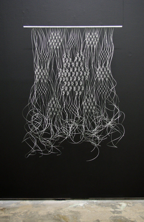 <i>Makramé</i>,       2011<br />      Wire cable,        120 x 65 cm<br />