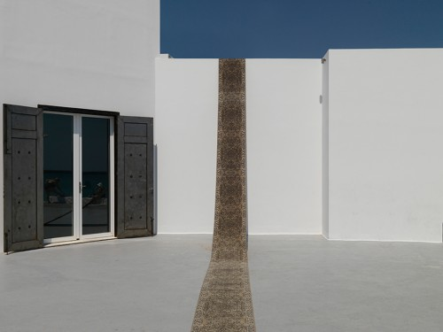 »Läufer [Rug] (serial)«,       2014<br />      Carpet,        67 x 2000 cm<br />      Installation view Art Space Pythagorion, Pythagóreio, Samos, Greece, 2014 (Photo by Stathis Mamalakis)