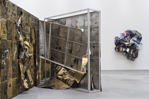 <i>Il balletto della crisi</i>,       1988<br />      newspaper, aluminium,        720 x 610 x 325 cm<br />      Exhibition view Neues Museum Nuremberg, Germany, 2016