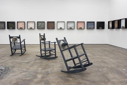 <i>Außer Atmen (Breathless)</i>,      1989/95/96<br />      7 kinetic rocking chairs,        Video by Trevor Good<br />      Exhibtion view 'Die Welt im Wohnzimmer`, WENTRUP, Berlin, Germany, 2017