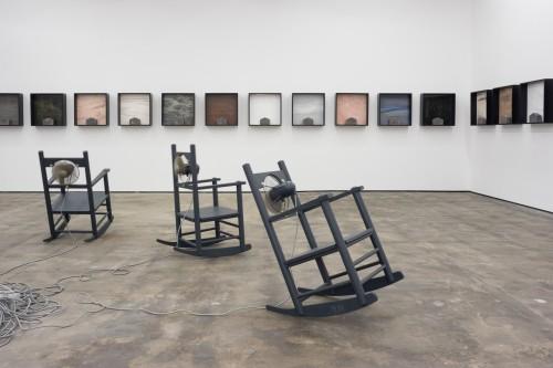 »Außer Atmen (Breathless)«,      1989/95/96<br />      7 kinetic rocking chairs,        Video by Trevor Good<br />      Installation view, WENTRUP, Berlin, Germany, 2017