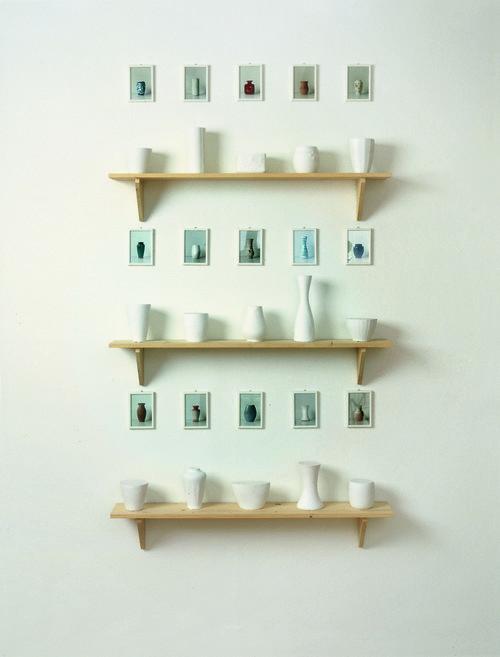 <i>Form und Inhalt (15 x 1 Liter) (form and content)</i>,       1982/1992<br />      plaster, wood, photo,        9 – 28,5 cm high (flower vases), 15 x 10 cm (photos), 19,8 x 120 x 19,8 cm (shelves)<br />