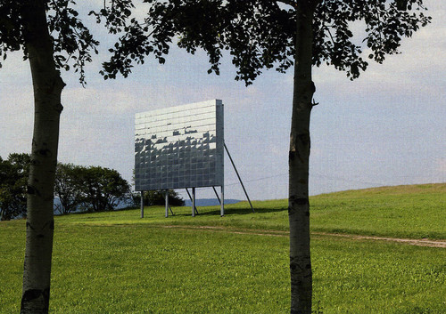 <i>Blinker II</i>,       2007<br />      Steel, mirror,        10 x 11.8 cm<br />      'Blinker II' is a kinectic light sculpture, consisting of a steelframe (1.000 x 1.183,5 cm) and 196 movable polished stainless steel mirrors (50 x 83 cm each)The singled mirrors, as well as the full mirrored screen ( 719,5 x 1.183,5 cm), equal the exact proportions of an conventional movie theater screen. The natural elements such as air and light, the sun and the wind, as well as the sky and earth, reflect on the screen to an atmospheric, playful natural spectacle of infinite diversity.