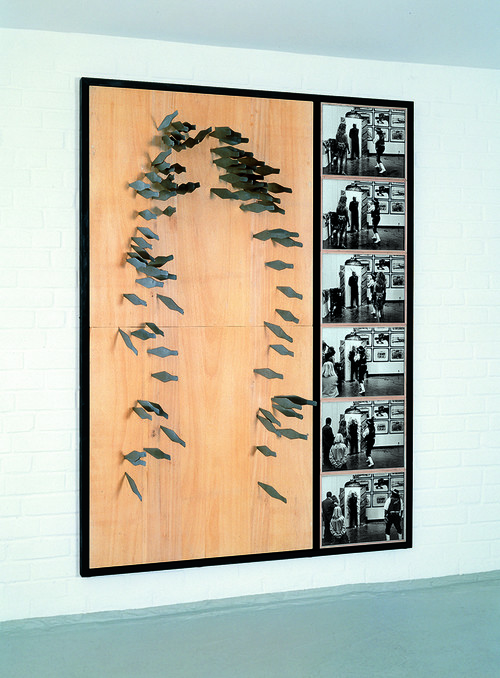 <i>Timm Ulrichs Messerwurf-Porträt</i>,       1978/1991<br />      90 stainless steel throwing knifes, wooden tablet,        200 x 100 cm<br />      A performance for Timm Ulrichs exhibition opening at Kunsthalle Recklinghausen in 1991. The knife were thrown by Jonny King.