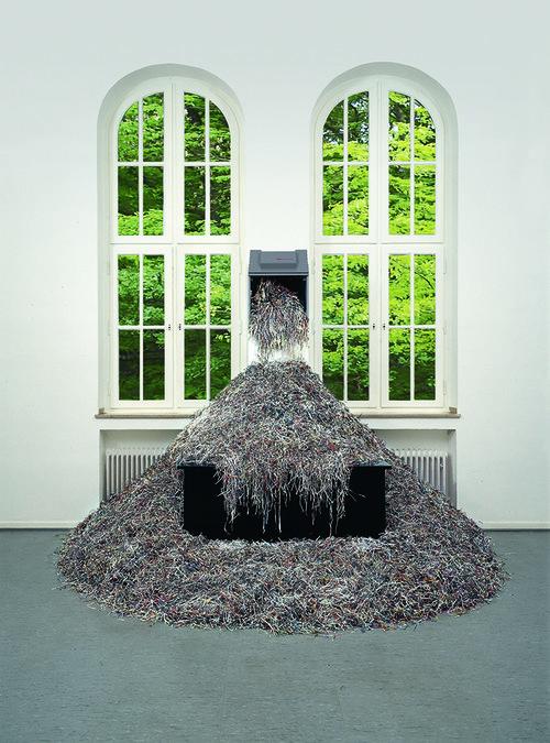 <i>Papier-Flut</i>,       1967/1994<br />      paper, shredder, table,        245 x 365 x220 cm<br />      happening-deconstruction-poetry (Aktions-Dekonstruktions-Poesie)