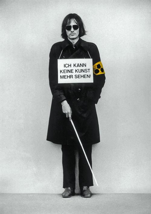 <i>Ich kann keine Kunst mehr sehen!</i>,       1975<br />             <br />      Demonstration as 'sandwich-man' with blindman's stick and courtesy armband for the visually impaired at 'Internationaler Kunstmarkt Köln, 1975.