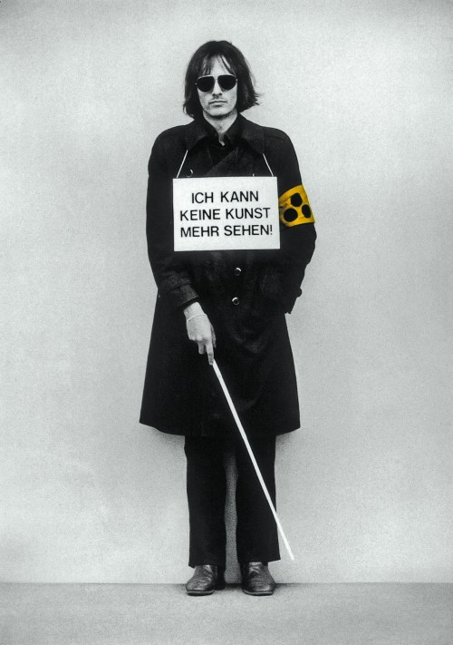 »Ich kann keine Kunst mehr sehen!«,       1975<br />             <br />      Demonstration as 'sandwich-man' with blindman's stick and courtesy armband for the visually impaired at 'Internationaler Kunstmarkt Köln, 1975.