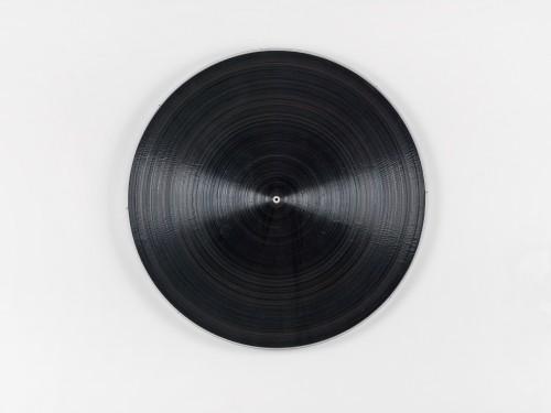 »schwarze Platte«, 2015<br />plexi, cassette tape, cassette wheels and wood, Ø 92 cm<br />