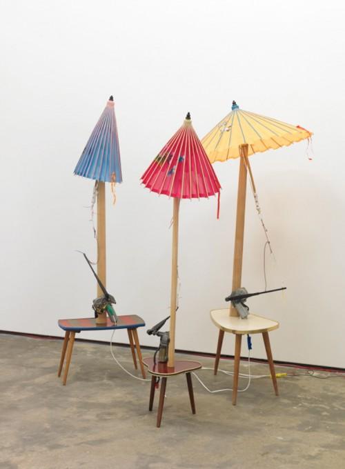 »Dennis,Sharon and Jack (aus der Serie Umbrellators)«, 2011<br />mixed media, 150 x 90 x 90 cm, 145 x 80 x 80 cm and 150 x 80 x 80 cm<br />