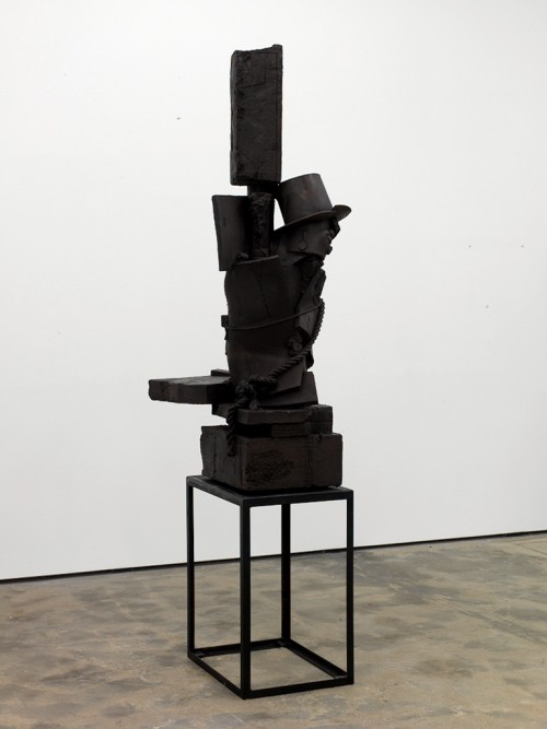 »When 9 turns to 6«, 2010<br />bronze, aeruginous, 290 x 90 x 73 cm<br />