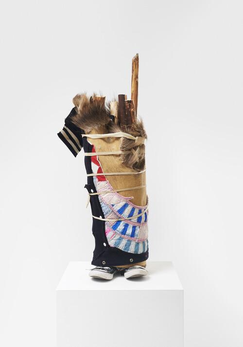 <i>Toes Out</i>, 2021<br />Converse shoes, spur, elk hide, textiles, leather, wood (lodge pole pine), 93 x 38 x 32 cm<br />
