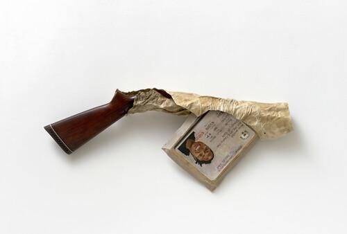 <i>Gag Gun</i>, 2021<br />Wood, deer rawhide, oil on linen, 36 x 88 x 9 cm<br />