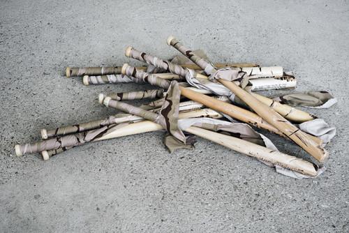 <i>Noch Fragen</i>, 2019<br />baseball bat, camouflage fabric, h = 80, t = 5 cm<br />
