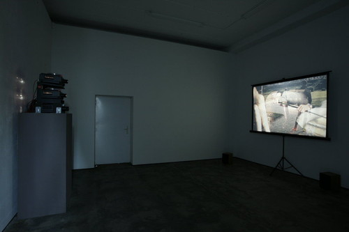 <i>Die Münze</i>, 2010<br />3-channel-slide-Projection with voice-over (approx. 23 mins, 242 slides, 3 Kodak Ektapro projectors, amplifier, apex, pair of speakers)<br />